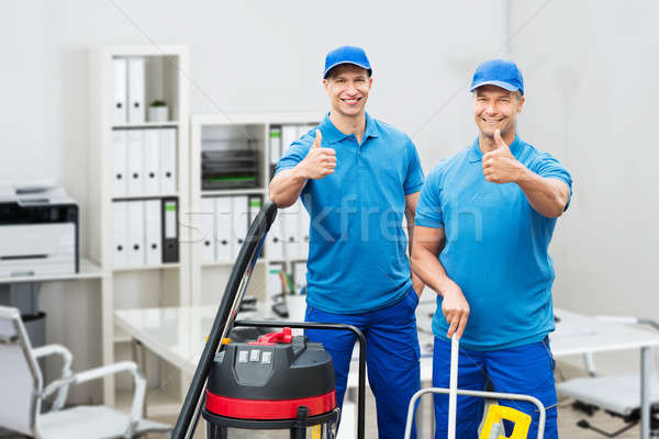 Two Male Cleaners Gesturing Thumbs Up Stock photo © AndreyPopov