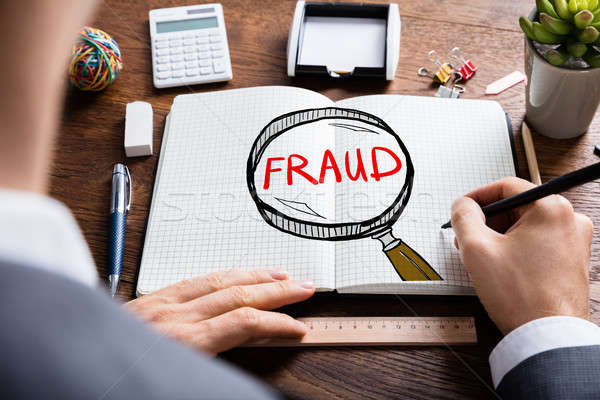 Man Drawing Fraud Investigation And Audit Stock photo © AndreyPopov