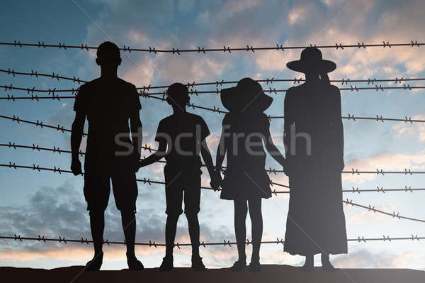Silhouette Of Refugee Family Stock photo © AndreyPopov