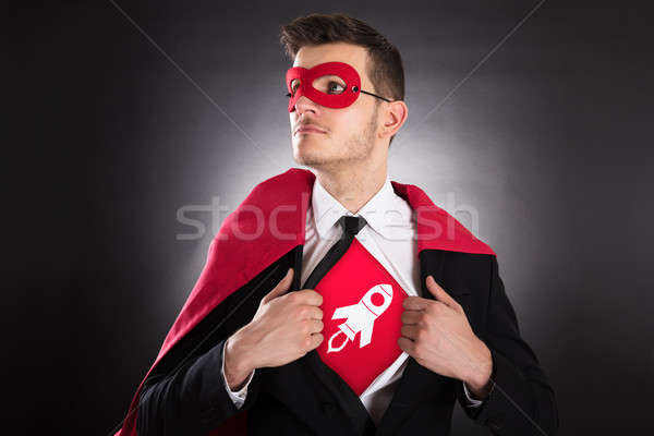 Businessman Opening Shirt For Showing Rocket Sign Stock photo © AndreyPopov