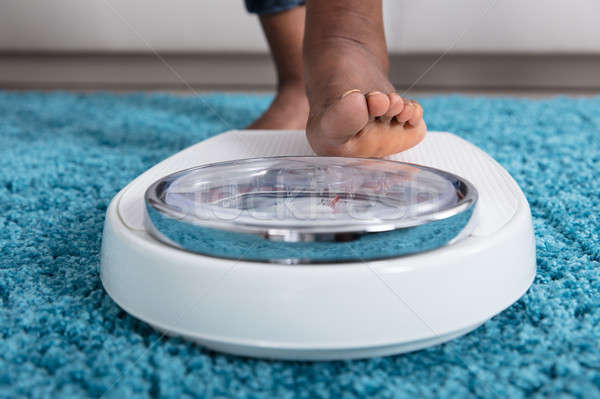 Human Foot Stepping On Weighing Scale Stock photo © AndreyPopov