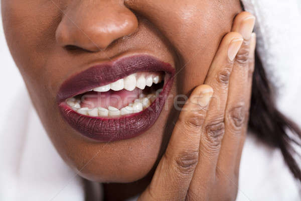 Woman Suffering From Tooth Ache Stock photo © AndreyPopov
