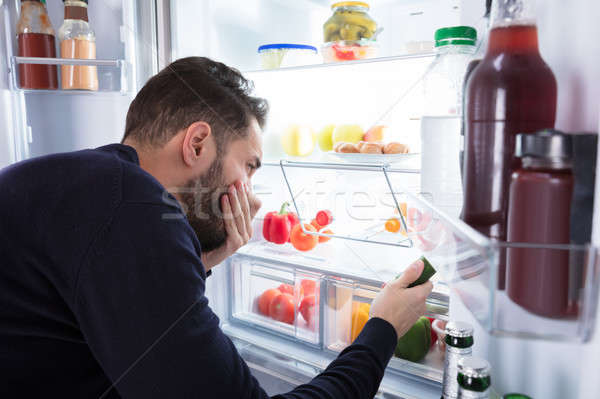 Man Noticing Smell Coming From Foul Food In Refrigerator Stock photo © AndreyPopov