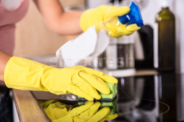 Person Hands Cleaning Induction Stove In Kitchen Stock photo © AndreyPopov
