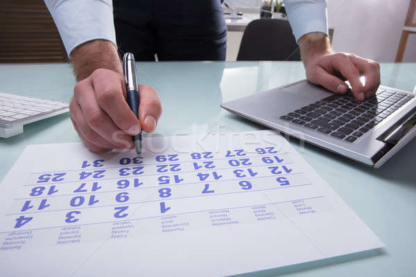 Businessperson Marking With Pen On Calendar Stock photo © AndreyPopov
