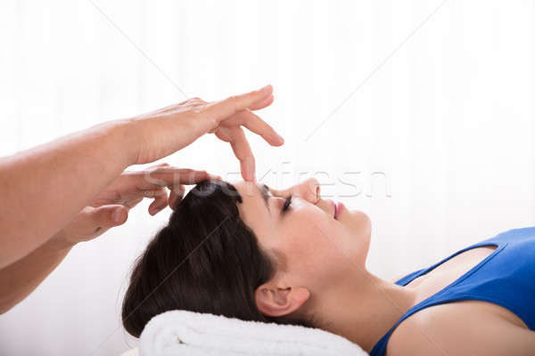 Calm Woman Receiving Reiki Treatment Stock photo © AndreyPopov