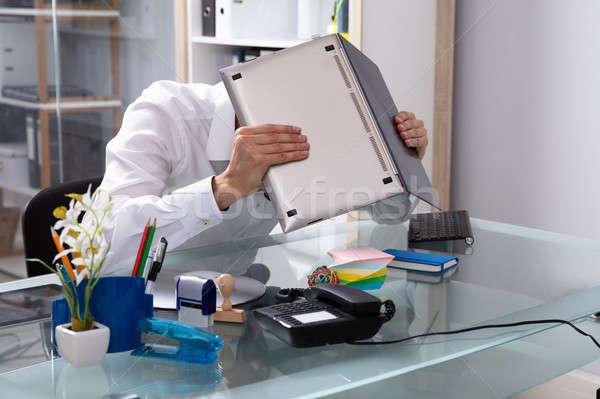 Empresario ocultación cara portátil oficina ordenador Foto stock © AndreyPopov