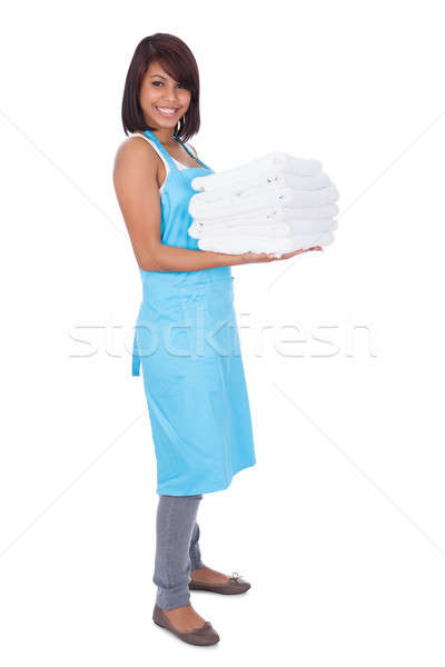 Smiling maid woman with towels Stock photo © AndreyPopov