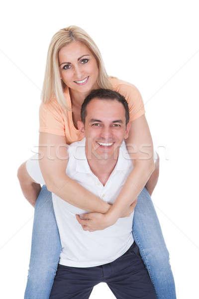 Man Piggybacking His Girlfriend Stock photo © AndreyPopov