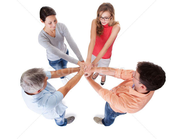 Four casual middle-aged friends holding hands Stock photo © AndreyPopov