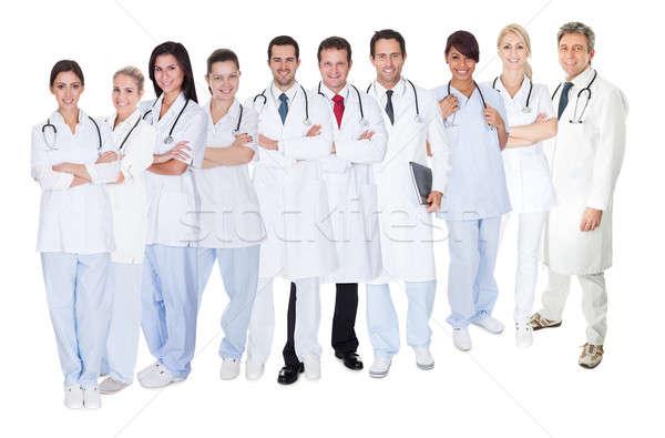 Grande gruppo medici isolato bianco donne Foto d'archivio © AndreyPopov