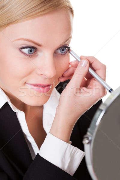 Aantrekkelijk zakenvrouw tekening eyeliner geïsoleerd witte Stockfoto © AndreyPopov