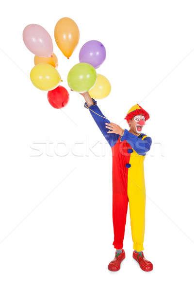 Stockfoto: Gelukkig · ballonnen · portret · clown · gekleurd · witte