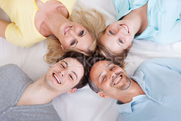 Joyful family with heads together Stock photo © AndreyPopov