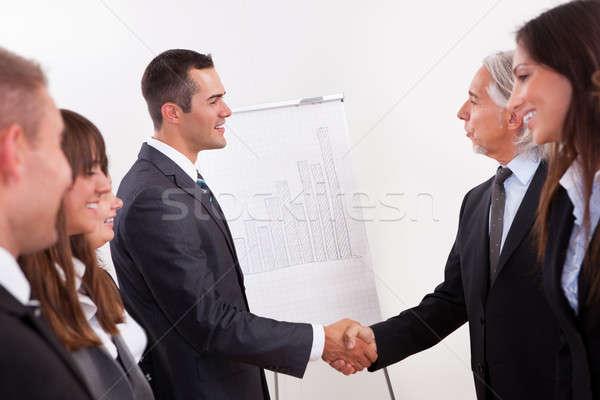 Dos empresarios apretón de manos saludo felicitaciones línea Foto stock © AndreyPopov