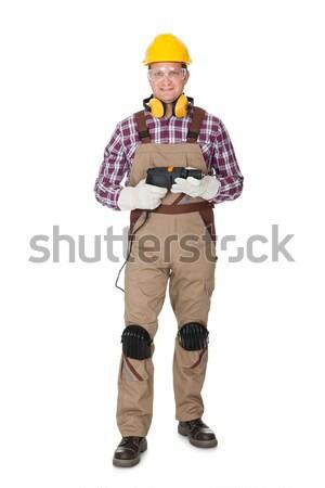 Portret pracownik budowlany odizolowany biały budowy tle Zdjęcia stock © AndreyPopov