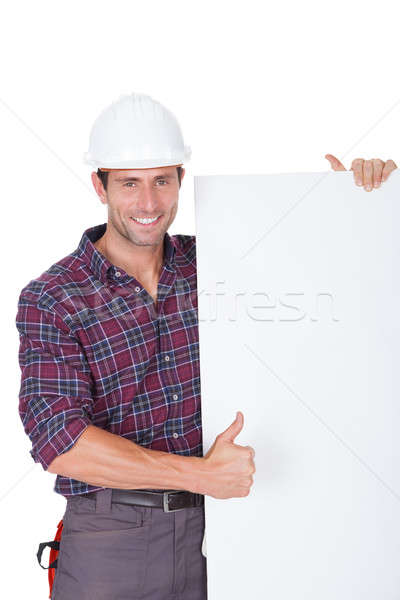 Man Wearing Hard Hat Holding Placard Stock photo © AndreyPopov