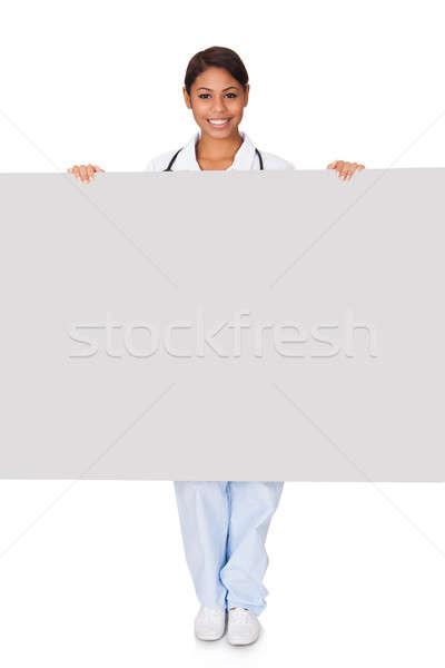 Boldog női orvos tart plakát izolált Stock fotó © AndreyPopov