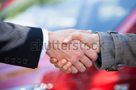 Car Dealer And Female Client Shaking Hands At Dealership Stock photo © AndreyPopov