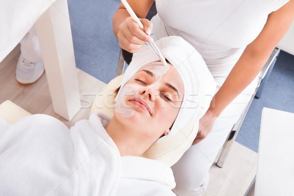 Terapeuta jelentkezik arc maszk nő gyönyörű Stock fotó © AndreyPopov