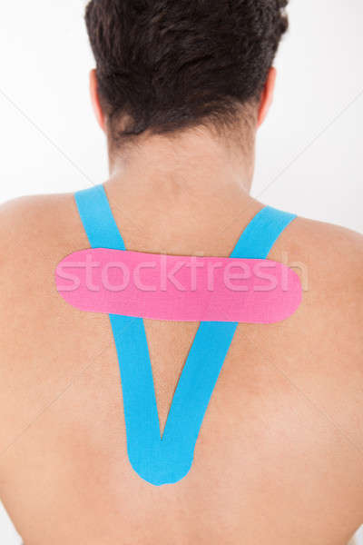 Rear View Of Young Man With Physio Stock photo © AndreyPopov