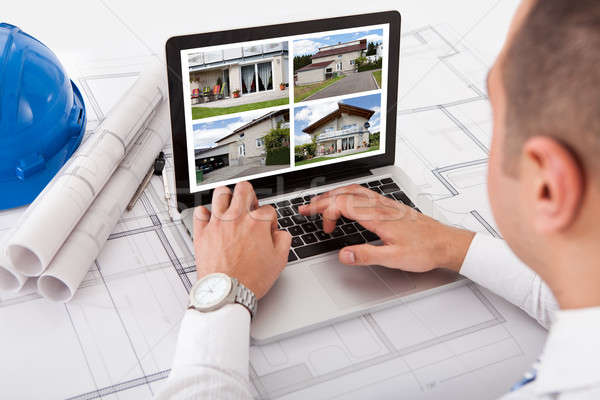 Architect Looking At Designs Of House On Laptop Stock photo © AndreyPopov