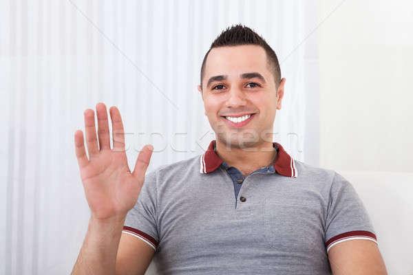 Happy Man Waving At Home Stock photo © AndreyPopov
