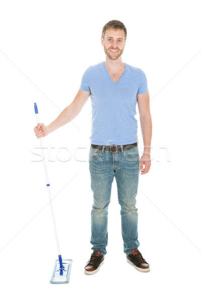 Portrait Of Happy Man Holding Mop Stock photo © AndreyPopov