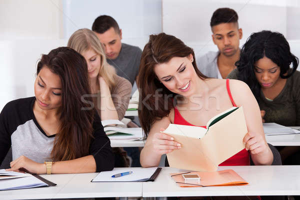 Stock photo: Happy Female Students Studying In Classroom