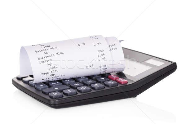Számológép nyugta tekert fehér pénz háttér Stock fotó © AndreyPopov
