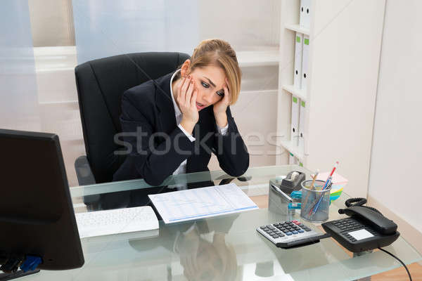 Businesswoman With Gantt Progress Chart At Desk Stock photo © AndreyPopov