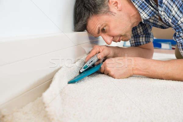 Kézműves vág szőnyeg közelkép kéz építkezés Stock fotó © AndreyPopov