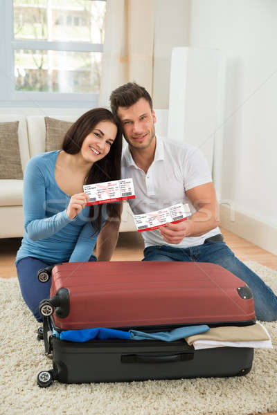 Happy Young Couple Showing Boarding Pass Stock photo © AndreyPopov