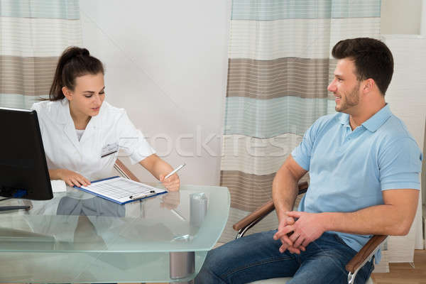Doctor Advising Male Patient Stock photo © AndreyPopov