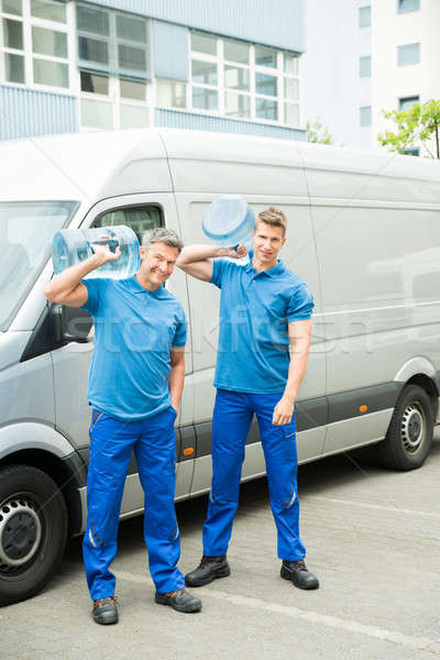Two Delivery Men Delivering Bottles Of Water Stock photo © AndreyPopov