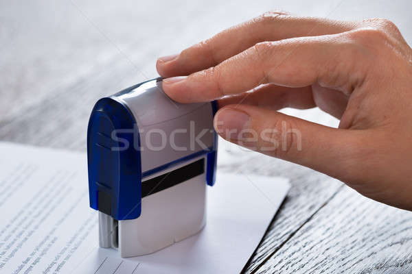 Person Hands With Stamper And Document Stock photo © AndreyPopov