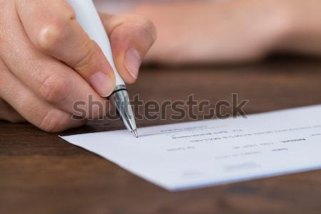 Személy kezek aláírás csekk közelkép fotó Stock fotó © AndreyPopov