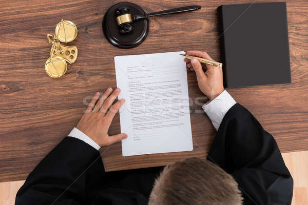 Stock photo: Judge Reading Paper In Courtroom
