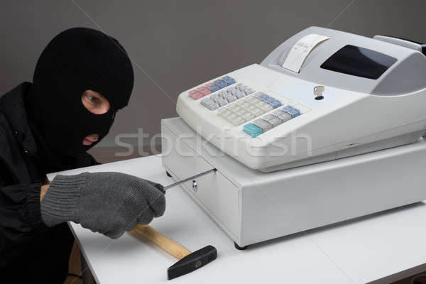 Thief Opening Cash Register Drawer Stock photo © AndreyPopov