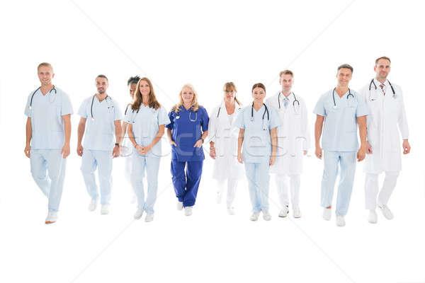 Confident Multiethnic Medical Team Walking In Row Stock photo © AndreyPopov