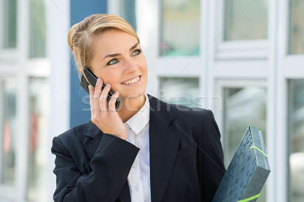 Businesswoman Using Mobile Phone Stock photo © AndreyPopov