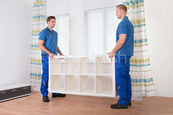 Movers Carrying Shelf At Home Stock photo © AndreyPopov