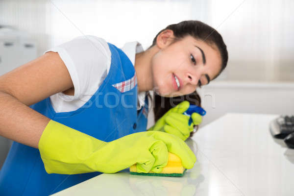 Janitor Cleaning Desk With Sponge At Office Stock photo © AndreyPopov