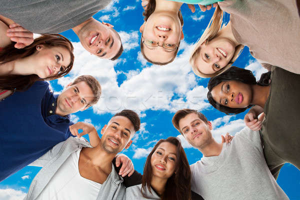 Happy Multiethnic College Students Forming Huddle Stock photo © AndreyPopov