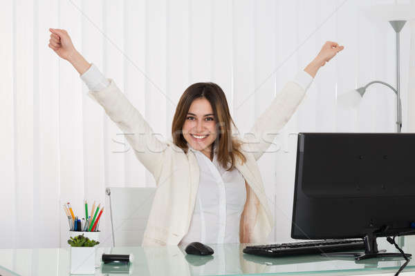 Businesswoman Raising Her Arms Stock photo © AndreyPopov