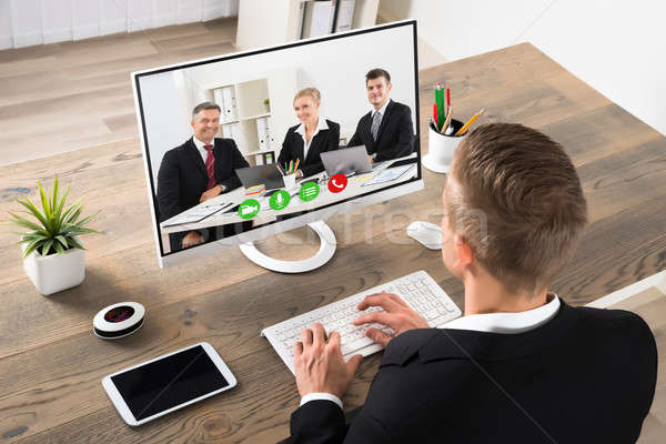 Stock photo: Businessman Attending Videoconference At Office