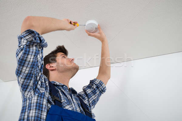 Electrician Repairing Fire Sensor Stock photo © AndreyPopov