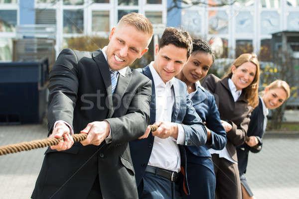 Multiethnic Businesspeople Playing Tug Of War Stock photo © AndreyPopov