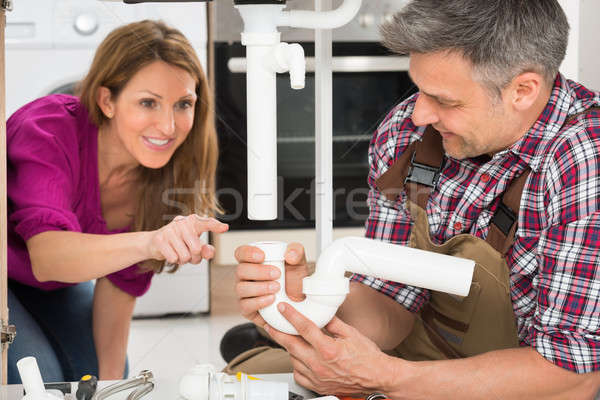 Male Plumber Holding Sink Pipe Stock photo © AndreyPopov