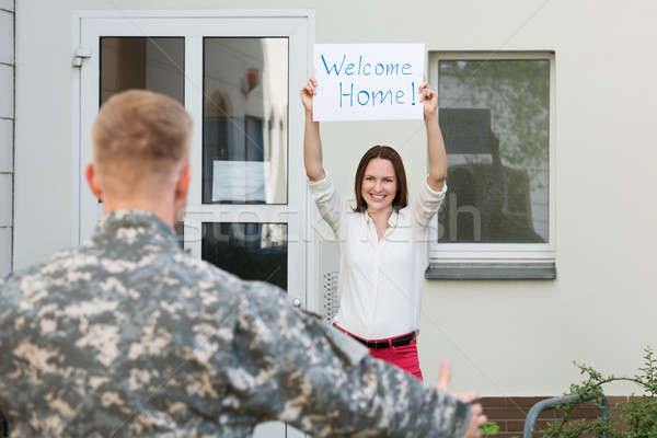 Wife Welcoming Her Husband Home Stock photo © AndreyPopov